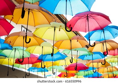 Street decoration with colorful open umbrellas hanging over the alley. Kosice, Slovakia. Color background
