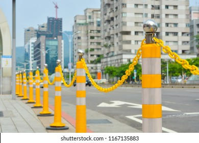 street delimited by yellow flexible pillar, close up traffic pillar
