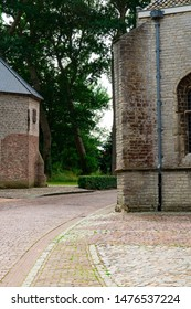 street with detail of Church and well in Veere, The Netherlands