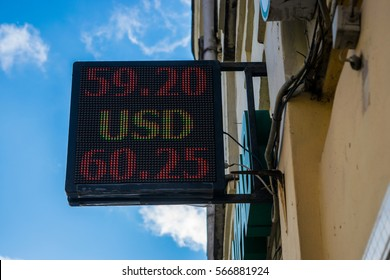 Street display showing currency exchange rate for dollar and ruble