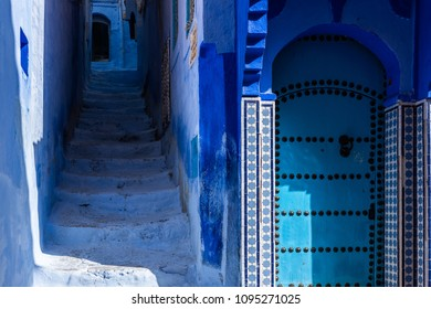 Street and door in the old Medina of Chefchaouen, the Moroccan blue city,
