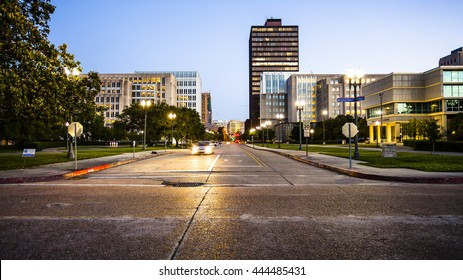 Street in downtown Baton Rouge, Louisiana as night falls - skyline