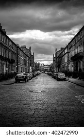 Street in Edinburgh With Parked Cars, Dramatic Sky, Clouds in Black and White