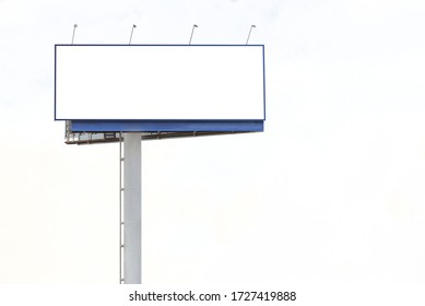 Street empty blank billboard for outdoor advertising poster with copy space on blue sky background. Billboard mockup outdoors
