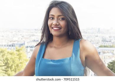 Street fashion concept. Portrait of elegant young beautiful woman. Paris buildings as background.