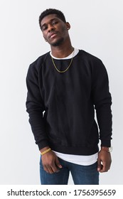 Street fashion concept - Studio shot of young handsome African man wearing sweatshirt against white background.