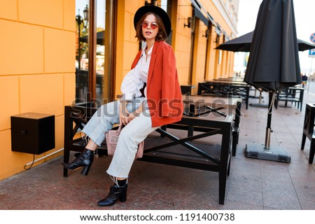 4788d7a2ee1 Amazing stylish traveling girl in trendy autumn outfit posing outdoor . Cafe