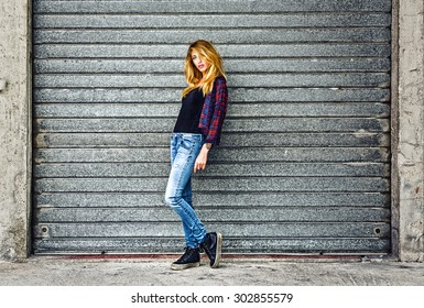 Street fashion portrait of sexy young woman