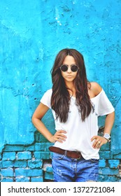 Street fashion portrait of stylish female model outdoor