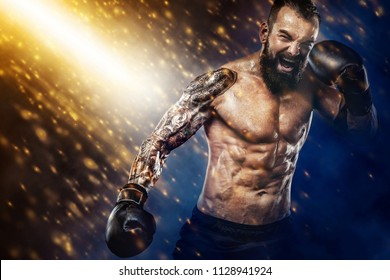 Street fighter fighting in boxing cage. Background with lights and smoke. Action shot with copy space.