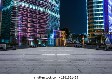 The street and the floor in front of the nocturnal office building