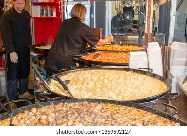 Street food being stirred in huge or giant frying pans. Manchester, UK - November 16th , 2015