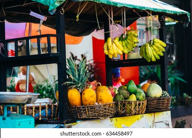 Street food counter with fruits on the street of Vientiane, Laos
