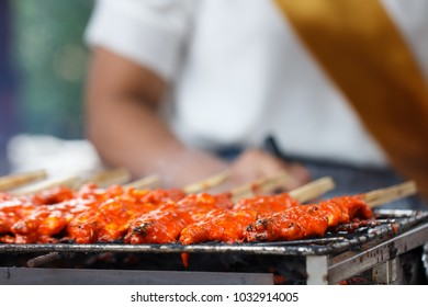 Street food, Grilled chicken on the flaming grill
