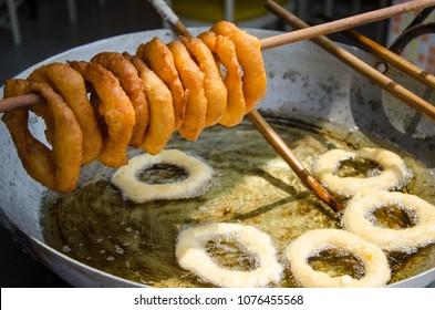 Street food preparation - traditional Peruvian sweets picarones