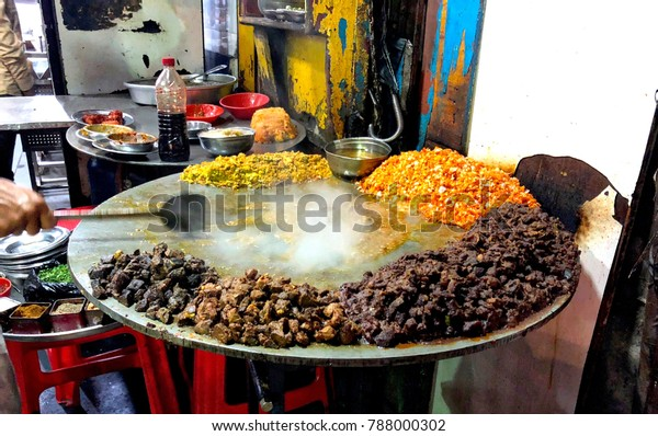 A street food seller at Mohammed Ali Road in Mumbai, India, rustles up fresh kebabs for customers.