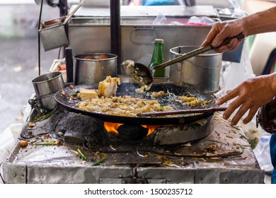 Street Food,Fresh food cooking  on sidewalk ,Easy food that is freshly prepared,Consisting of eggs, flour, oil and vegetables on the charcoal stove