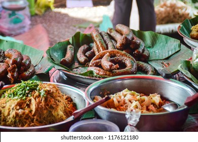 Street foods on the famous morning market in Luang Prabang. Sai oua, Lao grilled pork sausage. Sai kok, chunky Lao pork sausage.