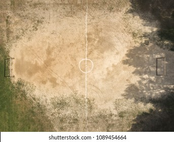 Street football field with sand and grass, top view,  flat lay.