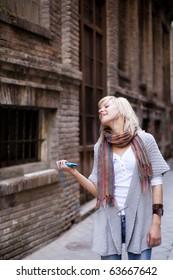 Street girl enjoying music