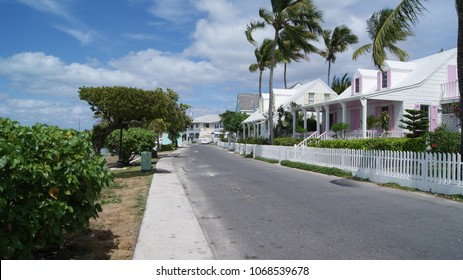 Street in Harbour Island, pink and white house, Eleuthera. Bahamas
