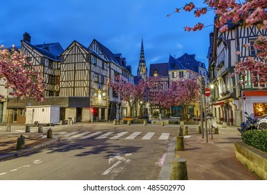 Street in historical center of Rouen with half-timbered houses, France. Evening