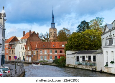 street of historical old town of Bruges with canal, Belgium