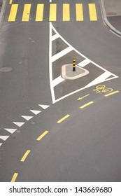 street intersection with yellow zebra crossing and bicycle lane, high angle view