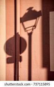 Street items reflected by shades on a facade