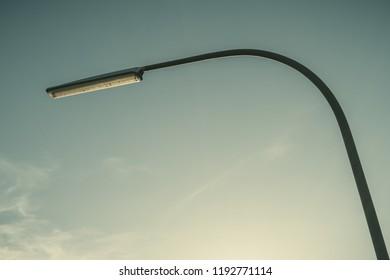Street lamp against the sun