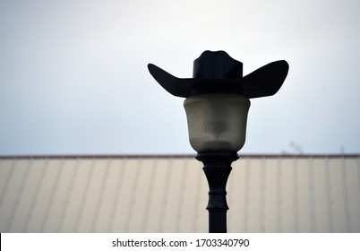 Street lamp with cowboy hat