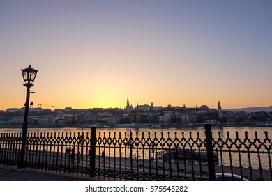Street Lamp with fence behind with sunset of Budapest cityscape 22 November 2016.