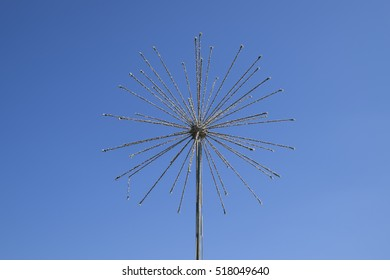 Street lamp in the form of fireworks. Garlands on a steel frame in the shape of a ball fireworks.