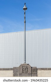 Street lamp in front of an industrial building
