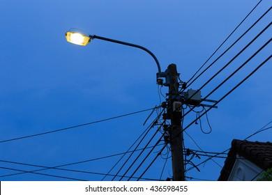 Street lamp (light on) at night