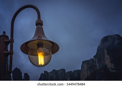 Street lamp lit at night in the small Kastraki settlement in Meteora at dusk, Trikala region, Greece