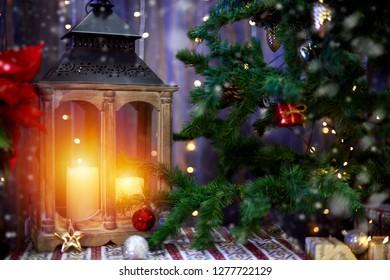 Street lamp near the Christmas tree. Christmas time scene.