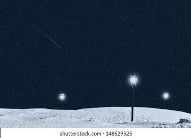 street lamp in the night under starry sky