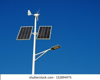Street lamp powered by solar panels and wind turbine