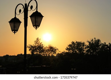 Street lamp and sunset in town