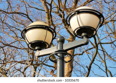 Street lamp with tree branches background
