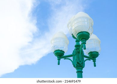 Street lamppost on blue sky and cloud
