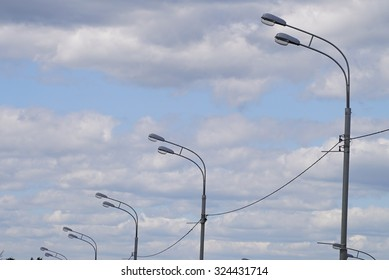 Street lamps with clowdy sky. Modern electric