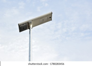 Street lamps on metal pole which received the electric power from photovoltaic panels above located beside the urban road of Thailand. Now, the green natural power from photovoltaic is new technology.