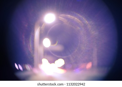 Street Lamps Over The Road In The Night Blurred Image shoot in violet colorized