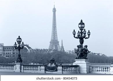 Street lantern on the Alexandre III Bridge against the Eiffel Tower in Paris, France.