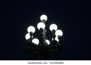 A Street lantern over black night sky