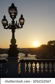 Street lantern sunset view from bridge in Paris