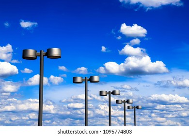 Street lanterns of steel color against the blue sky and beautiful clouds, city Dnipro, Ukraine (Dnepropetrovsk, Dnepr)