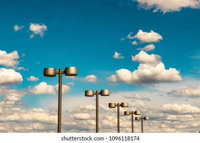 Street lanterns of steel color against the blue sky and beautiful clouds,  Dnipro city , Ukraine ( Dnepr, Dnepropetrovsk).